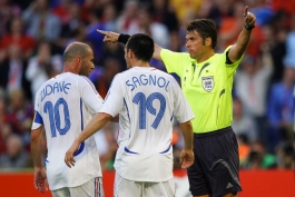 Zinedine Zidane, Willy Sagnol (FRA) and Roberto Rosetti (Referee) during the 2nd round match of the 2006 FIFA World Cup between France and Spain in Hanover, Germany. France won 3-1